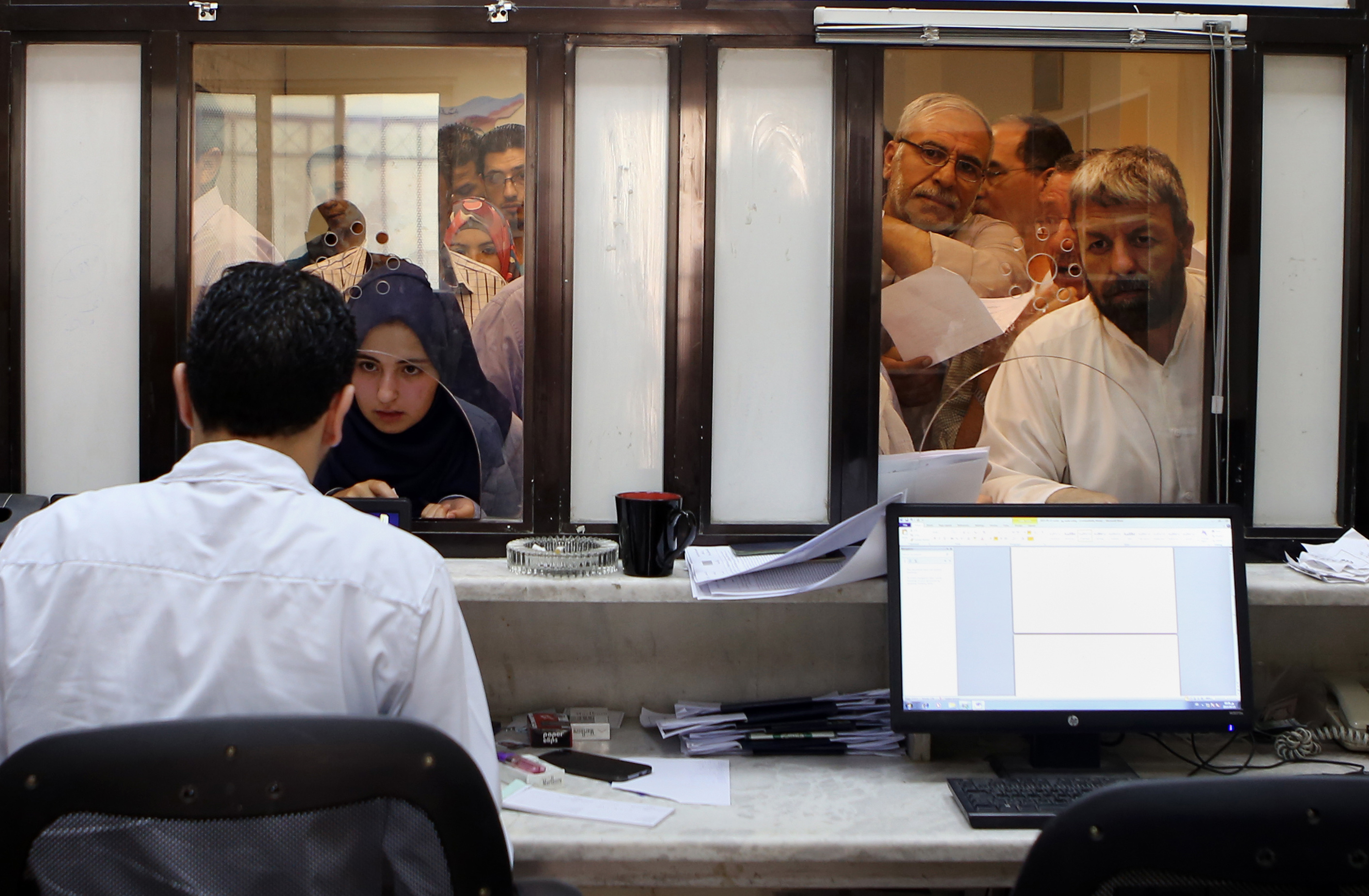 Syrian Refugees Apply For Passports Tuesday Inside Their Embassy In Amman  Hundreds Of Syrian Refugees