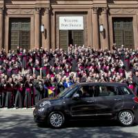 Pope Francis leaves St. Mathews Cathedral in his Fiat 500 after a midday prayer service in Washington, Wednesday, as bishops applaud.   AP