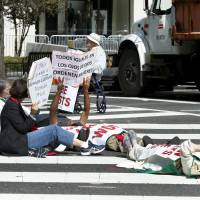 Protesters block a street outside Saint Matthew's Cathedral in Washington during Pope Francis' prayer meeting with U.S. bishops Wednesday. | REUTERS