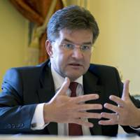 Slovakia Foreign Minister Miroslav Lajcak speaks during an interview with the Associated Press in Bucharest Wednesday. Lajcak says the flood of migrants crossing Europe could unite the far-right in his country, calling it a 'scary' prospect. | AP