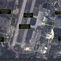 This September satellite image with annotations provided by GeoNorth, AllSource Analysis, Airbus shows Russian transport aircraft, helicopters, tanks, trucks and armed personnel carriers at an air base in Latakia province, Syria. Russia on Thursday strongly urged the United States and its allies to engage the Syrian government as a 'partner' in the fight against the Islamic State group, and offered to share any information about its military supplies to Damascus with Washington. Syria's army has reportedly started using sophisticated Russia-supplied arms. | GEONORTH, ALLSOURCE ANALYSIS, AIRBUS VIA AP