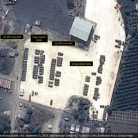 This Tuesday satellite image with annotations provided by GeoNorth, AllSource Analysis, Airbus shows Russian tanks and armed personnel carriers at an air base in Latakia province, Syria. | GEONORTH, ALLSOURCE ANALYSIS, AIRBUS VIA AP