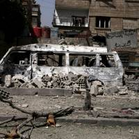 A damaged van is pictured among rubble after what activists said was an airstrike by forces loyal to Syria's President Bashar Assad on the town of Douma, eastern Ghouta of Damascus on Thursday. | REUTERS