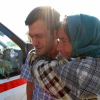 Father buries drowned toddler, family in Syria: witness