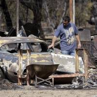 Northern California wildfire partially under control after gutting 585 homes, displacing 13,000 people