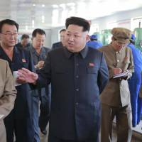 North Korean leader Kim Jong Un visits the Sinuiju Measuring Instrument Factory in this undated photo released by North Korea's Korean Central News Agency (KCNA) in Pyongyang on Friday. IAEA chief Yukiya Amano said Monday that the North appears to be renovating its Yongbyon nuclear site. | KCNA / REUTERS