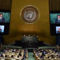 Prime Minister Shinzo Abe speaks to the United Nations Sustainable Development Summit at the United Nations General Assembly in New York Sunday.   AFP-JIJI