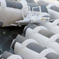 A broken drone sits on the roof of Himeji Castle's fifth floor after apparently crashing into the national treasure in Himeji, Hyogo Prefecture, Saturday morning. | HIMEJI MUNICIPAL GOVERNMENT/KYODO