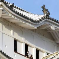 Police inspect the scene of a drone crash at Himeji Castle, a national treasure in Himeji, Hyogo Prefecture, on Saturday. | KYODO