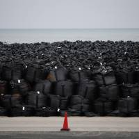 Flooding swept away radiation cleanup bags in Fukushima