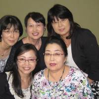 Members of a mothers' support group pose for a photo after meeting in Tokyo in June 2014. | BETERAN MAMA NO KAI