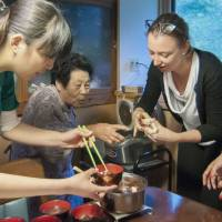 Tourists experience home-style hospitality in Iwate Prefecture using a booking made on Tomarina, a home-sharing website run by Tokyo-based Tomareru Inc. | TOMARERU INC. / KYODO