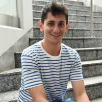 Ari Beser, the grandson of the only U.S. serviceman aboard both planes that dropped atomic bombs on Hiroshima and Nagasaki, talks about his project to spread the stories of atomic bomb survivors during an interview in Tokyo's Harajuku district in September. | SATOKO KAWASAKI