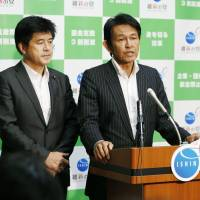 Ishin no To (Japan Innovation Party) head Yorihisa Matsuno speaks at a news conference Tuesday in the Diet to announce a party executive shake-up as new Secretary-General Masato Imai looks on. | KYODO