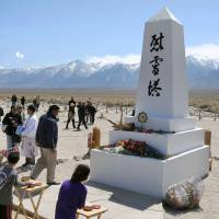 People pray for the Japanese-Americans interned during World War II at the Manzanar camp in California, during an annual pilgrimage to the site in April. | KYODO