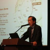 Former Prime Minister Naoto Kan speaks about his experience with the Fukushima nuclear disaster to foreign residents in Tokyo during a lecture Wednesday. | KAZUAKI NAGATA
