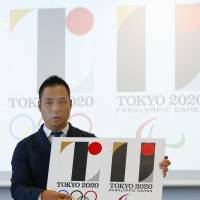 Kenjiro Sano, designer of the main 2020 Tokyo Olympics logo (left), denies plagiarism in Tokyo on Aug. 5. | KYODO