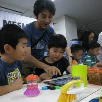 Children and parents try out Sony's MESH at a Workshop Collection in Shibuya on Aug. 30. | KAZUAKI NAGATA