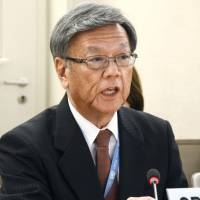 Okinawa Gov. Takeshi Onaga addresses a meeting of the United Nations Human Rights Council in Geneva on Monday. | KYODO