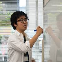 A university student teaches class at the Tadazemi free cram school for junior high school students in Tokyo.   BLOOMBERG