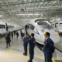 High-speed trains are assembled at a factory in China's Hebei province in February. | KYODO