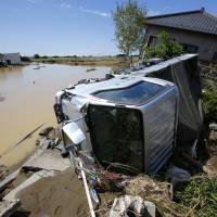 The sun came out a day after a raging river washed away houses and forced people to rooftops as dozens of residents were airlifted out by military helicopters Friday morning after waiting overnight in the city.   AP