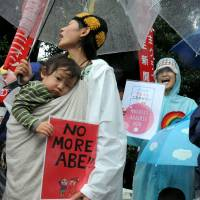 People stage a protest against the government-sponsored security legislation in front of the Diet building in Tokyo on Thursday as the ruling bloc presses hard for its passage. | SATOKO KAWASAKI