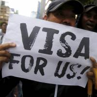 Protesters call on Japan to give asylum seekers visas, on Wednesday in central Tokyo. | REUTERS