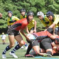 Members of rugby teams from high schools across Japan compete at the annual Gose rugby festival in Gose, Nara Prefecture, on July 21. | KYODO