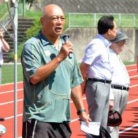 Hiroyuki Takeda, coach of Gose Industrial High School's rugby team, speaks during the Gose rugby festival in Gose, Nara Prefecture, on July 21. The festival, which started in 1991, brings together players from across Japan. | KYODO