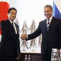 Foreign Minister Fumio Kishida is greeted by Russian First Deputy Prime Minister Igor Shuvalov at the beginning of the Japan-Russia Intergovernmental Committee on Trade and Economic Issues in Moscow on Tuesday. | KYODO
