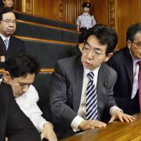 Leaders of the opposition parties, including Social Democratic Party leader Mizuho Fukushima (top row) and Democratic Party of Japan leader Katsuya Okada (right), react after the controversial security bills passed the Upper House early Saturday morning.  | KYODO