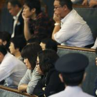 Visitors in the Upper House gallery watch lawmakers vote on a no-confidence motion filed by the opposition against the body's president, Masaaki Yamazaki, during a plenary session Friday. | AP