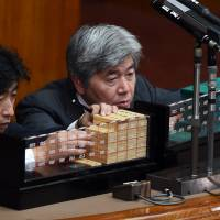 Clerks count ballots in a censure resolution against Upper House President Masaaki Yamazaki, which took place as the government attempted to pass two contentious security bills Friday. | AFP-JIJI