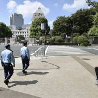 Calm returns to areas around the Diet building Saturday with protesters gone after the Diet passed the contentious security laws earlier in the day. | KYODO