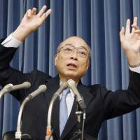 University of Tokyo professor emeritus Noboru Kashiwagi, who heads a third-party panel probing the fiasco over construction of a new National Stadium, speaks at a news conference at the sports ministry on Thursday. | KYODO