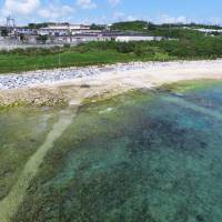 Channels believed to be carrying cables for a top-secret submarine detection system are seen Tuesday running into the sea from the U.S. Navy's White Beach base in Uruma, Okinawa Prefecture, where the MSDF Oceanographic Observation is located. | KYODO