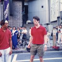 Patrick Harlan performs one of his first comedy sketches with his partner, Makoto Yoshida, in Shibuya, Tokyo, in 1996. | COURTESY OF PATRICK HARLAN