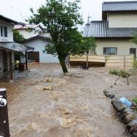 A residential area is flooded following torrential rain in Kanuma, Tochigi Prefecture, on Thursday. | KYODO