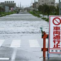 A flooded road in Hamamatsu, Shizuoka Prefecture, is sclosed Wednesday morning, as Typhoon Etau landed in neighboring Aichi Prefecture. | KYODO