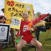 Senior sprinter dubbed 'Golden Bolt' sets world record