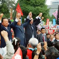 Ichiro Ozawa of the People's Life Party (left), Katsuya Okada of the Democratic Party of Japan (center) and Kazuo Shii of the Japanese Communist Party join a protest in front of the Diet on Aug. 30.  | KYODO