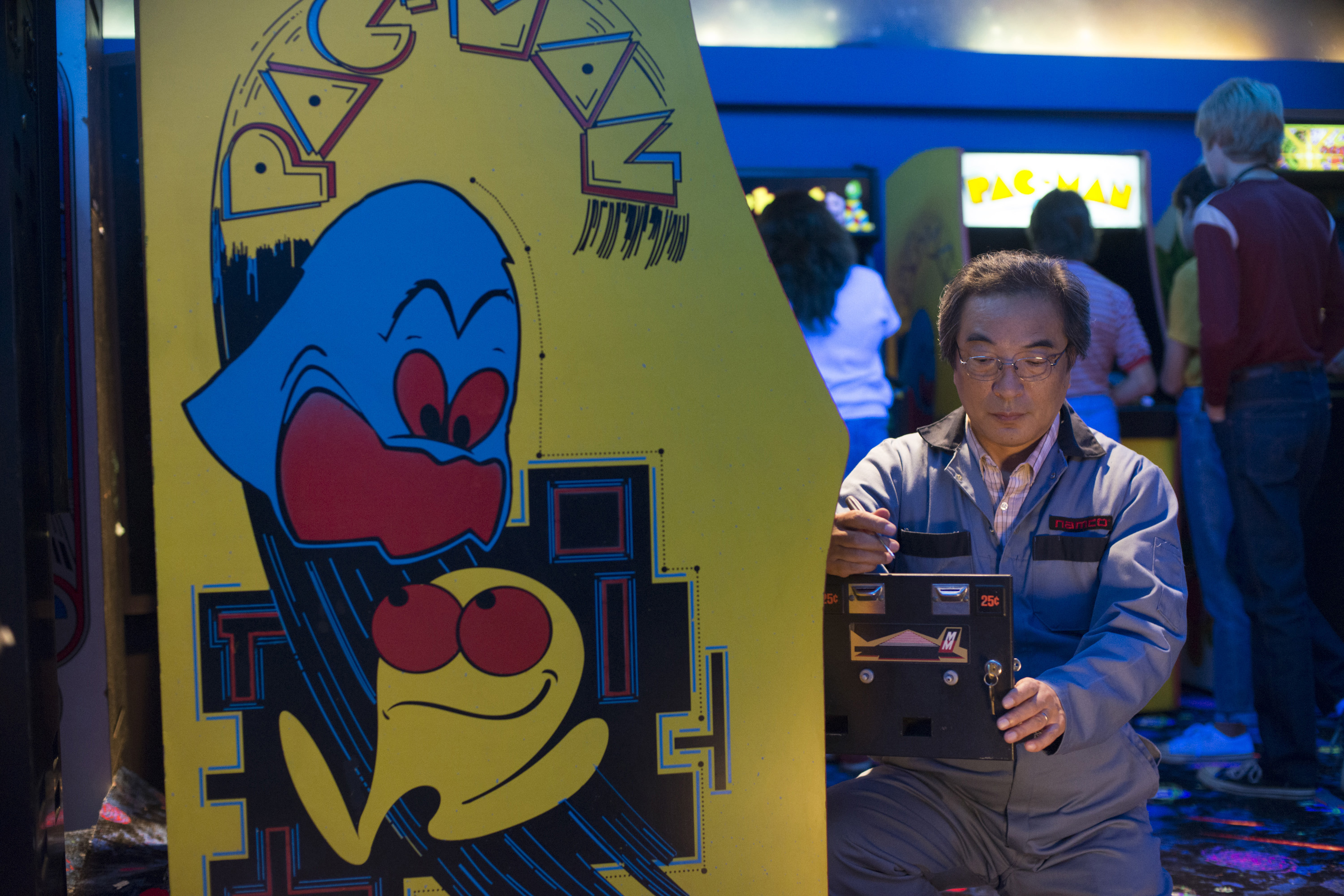 Some things can't be fixed: The real-life creator of Pac-Man, Toru Iwatani, makes a cameo in 'Pixels' as a repairman. Back in Japan, Iwatani works as a professor at Tokyo Polytechnic University teaching game design.   © 2015 CTMG, INC. ALL RIGHTS RESERVED.