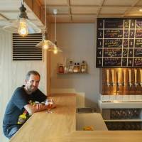 Beer magician: Mikkel Borg Bjergso, who runs Danish microbrewery Mikkeller, sits at the counter to his newest bar, which opened in August along a backstreet of Tokyo's Shibuya district. | SATOSHI NAGARE