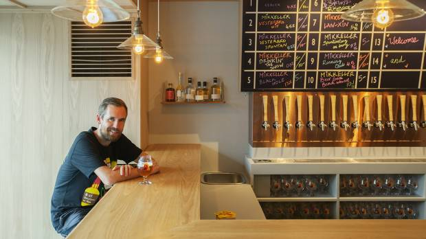 Beer magician: Mikkel Borg Bjergso, who runs Danish microbrewery Mikkeller, sits at the counter to his newest bar, which opened in August along a backstreet of Tokyo's Shibuya district.