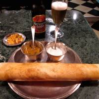The dosa pancake, offered either plain or masala (stuffed with spicy potatoes), at Dharmasagara, a go-to spot in Higashi-Ginza for South Indian cuisine.  | ROBBIE SWINNERTON