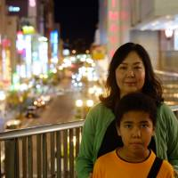 Yoko — Emeka Igwilo's wife — and her youngest son, Roy, pose for a photo during a vacation in Japan.   DREUX RICHARD PHOTO