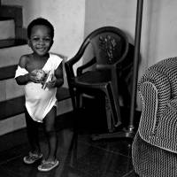 Paul's daughter plays with a toy shinkansen at home in Nigeria in 2014.   DREUX RICHARD PHOTO