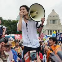Youth gone wild: Students Emergency Action for Liberal Democracy co-founder Aki Okuda speaks to supporters  in front of the Diet in Tokyo on Aug. 30. | KYODO