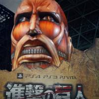 Under attack: A display advertises Koei Temco's 'Attack on Titan' video game at the Tokyo Game Show on Thursday. The event runs through Sunday and will be open to the public from Saturday. | JASON COSKREY